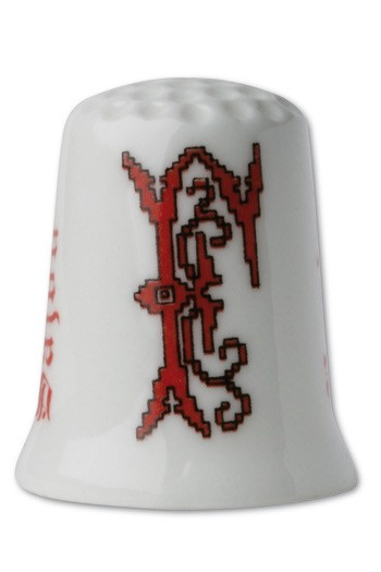 Collectors thimble imitating red crosstich Letter F