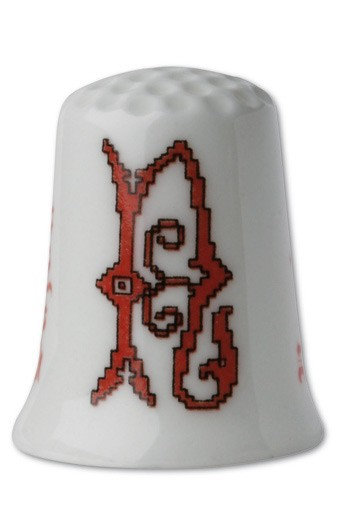 Collectors thimble imitating red crosstich Letter N