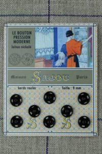 8 black coloured 9mm press fasteners vintage style card