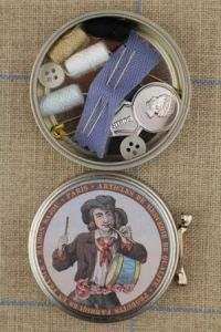 Sajou drummer boy metal tin containing a travel sewing set