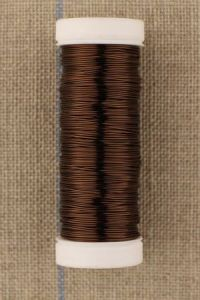 Spool of thick metal thread Lebaufil brown colour