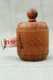 Hornbeam wooden dressmaker's tape measure red ribbon