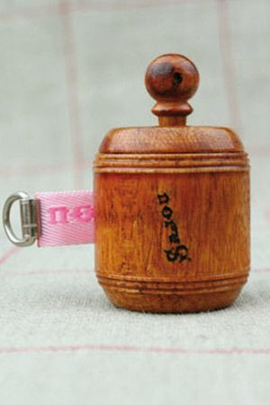 Hornbeam wooden dressmaker's tape measure pink ribbon