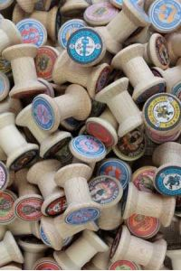 50 Sajou miniature wooden bobbins with random labels