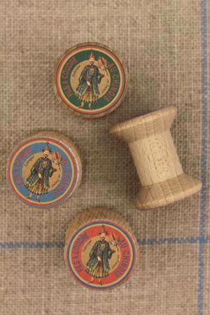 """4 miniature wooden bobbins with """"Fil Au Chinois"""" labels"""