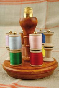 Small wooden holder for miniature bobbins