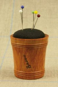Hornbeam wooden pin cushion covered with black linen fabric