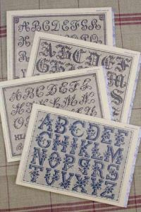 mauve Sajou album n°106 : 4 cross stitch alphabets