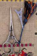 Chromed Eiffel Tower embroidery scissors with blue charm