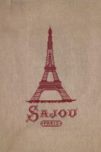 Natural linen tea towel printed with a red Eiffel tower in cross stitch