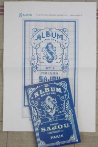 Cross stich pattern chart: Cover for the Blue Sajou Albums series