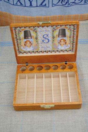 Wooden display case for thimbles and seven thimbles