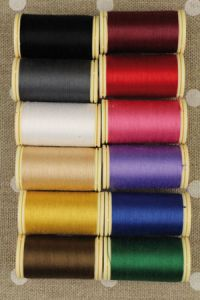 Twelve colours in Fil Au Chinois cotton thread assortment - dark tones