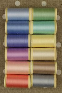 Twelve colours in Fil Au Chinois cotton thread assortment - pastel tones