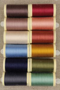 Twelve colours in Fil Au Chinois cotton thread assortment - vintage tones