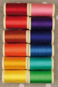 Twelve colours in Fil Au Chinois cotton thread assortment - bright tones