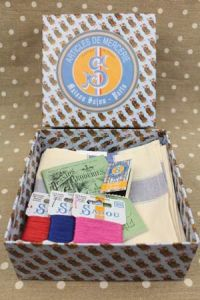 Gift box with three tea towels pink blue and red