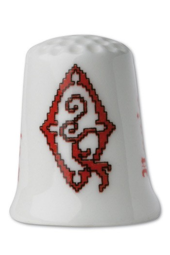Collectors thimble imitating red crosstich Letter Q