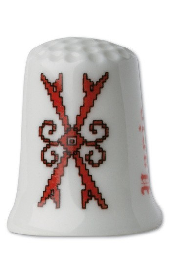 Collectors thimble imitating red crosstich Letter X